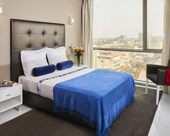 Rk Suite Hotel - Luanda - Schlafzimmer