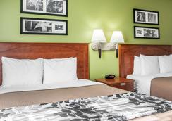 Sleep Inn and Suites Conference Center and Water Park - Minot - Bedroom