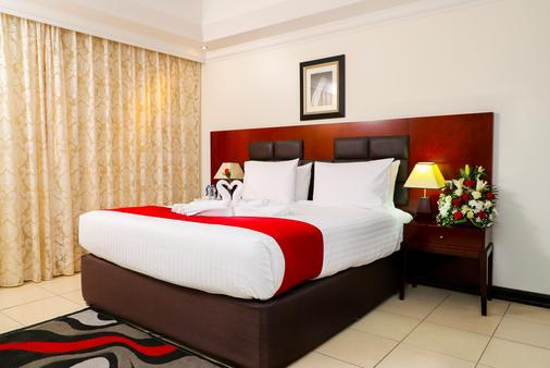 Ewan Ajman Suites Hotel - Ajman - Chambre