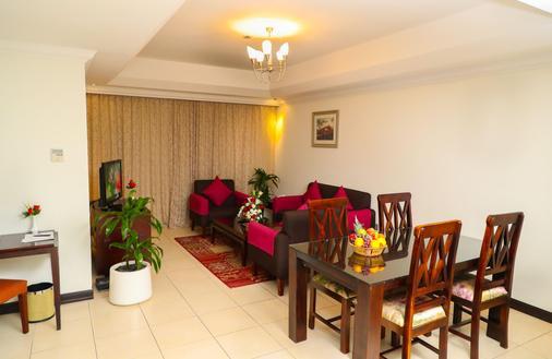 Ewan Ajman Suites Hotel - Ajman - Ruokailuhuone