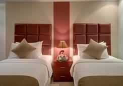 Ewan Ajman Suites Hotel - Ajman - Makuuhuone