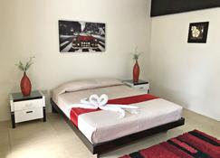 Quezon Premier Hotel Candelaria - Candelaria - Habitación
