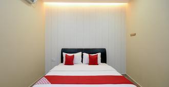 OYO 89301 Ys Inn - Miri - Bedroom