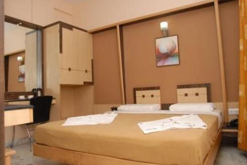 Hotel Manasa Paradise - Bengaluru - Schlafzimmer