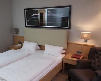Hotel Brunnenhof International - Wedemark - Bedroom
