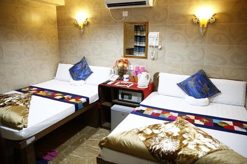 Sandhu Hotel - Hongkong - Schlafzimmer