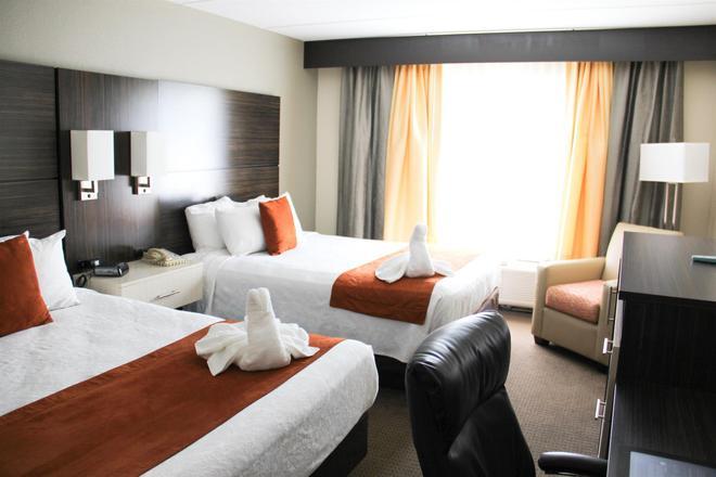 Best Western Airport Inn & Suites - Orlando - Quarto