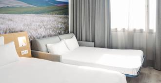 نوفوتيل سيفيليا - إشبيلية - غرفة نوم