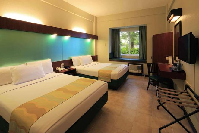 Microtel by Wyndham Tarlac - Tarlac City - Bedroom