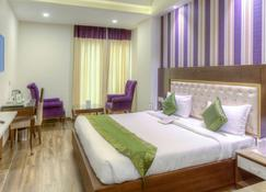 Treebo Tryst Sc Residency - Chandigarh - Bedroom