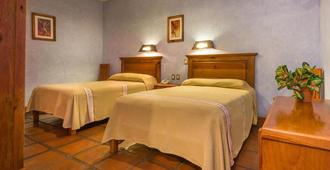 Hotel Refugio del Angel - פצקוארו - חדר שינה