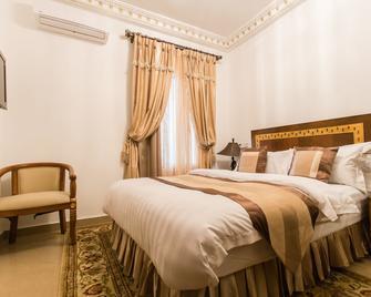 Résidence Hôtelière Le Jomonia - Libreville - Schlafzimmer