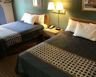 Travelodge by Wyndham Worland - Worland - Bedroom