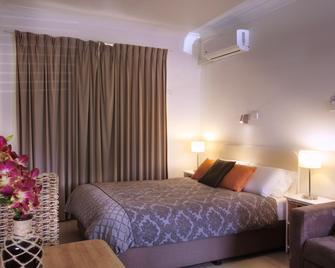 Tuncurry Motor Lodge - Tuncurry - Спальня