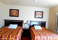 Crossroads Inn & Suites - Victoria - Bedroom