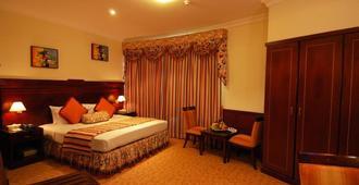 Ramee California Hotel - Manama - Bedroom