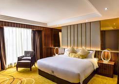 Moty Hotel - Malakka - Schlafzimmer