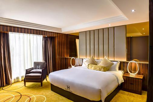 Moty Hotel - Малакка - Спальня