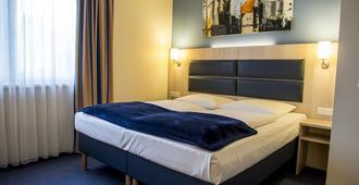 Hotel Rödelheimer Hof - Am Wasserturm - פרנקפורט אם מיין - חדר שינה