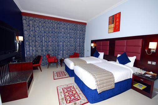 Ramee Rose Hotel Apartments - Abu Dhabi - Makuuhuone
