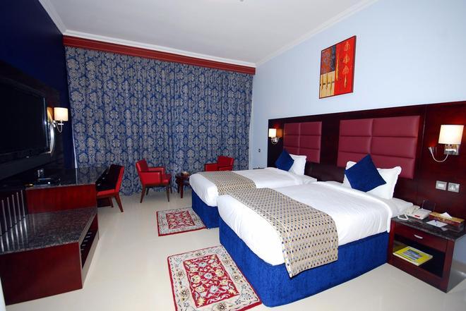 Ramee Rose Hotel Apartments - Abu Dabi - Habitación