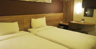 G7 Hotel - ג'קרטה - חדר שינה