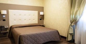 Ih Hotels Bologna Amadeus - Bologna - Phòng ngủ
