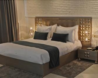 Hospitality Inn - Nouaseur - Schlafzimmer
