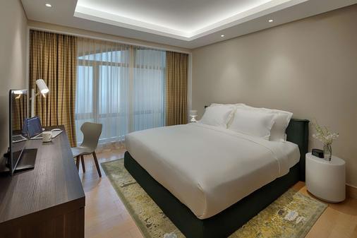 謝伍德套房酒店 - 胡志明市 - 臥室