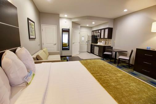 Days Inn & Suites by Wyndham Port Arthur - Port Arthur - Schlafzimmer
