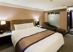 โรงแรมแกรนด์ฟอร์เวิร์ด - ป่านเฉียว - ห้องนอน