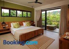 Le Repaire - Boutique Hotel & Restaurant - La Digue Island - Bedroom