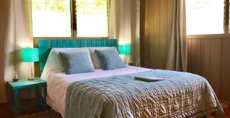 Kaumana Caves Inn - Hilo - Bedroom