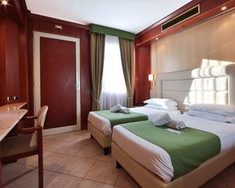 Best Western Hotel Anthurium - Santo Stefano al Mare - Schlafzimmer