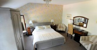 ذا تاور هوتل - لينكولن - غرفة نوم