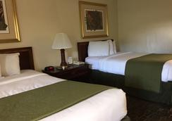 Sawgrass Inn & Conference Center - Plantation - Schlafzimmer