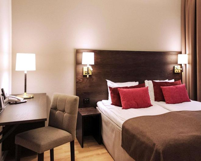 Clarion Collection Hotel Drott - Кaрлcтaд - Спальня