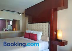 達爾西內亞套房酒店 - 拉普拉普 - 麥克坦 - 臥室