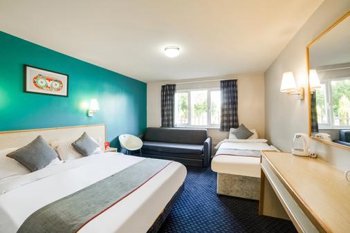 OYO Sunrise Hotel - Leicester - Schlafzimmer