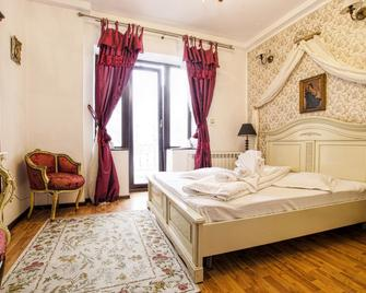 Coroana Moldovei Hotel - Slanic Moldova - Schlafzimmer