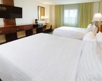 Holiday Inn Hotel & Suites Hermosillo Aeropuerto - Hermosillo - Bedroom