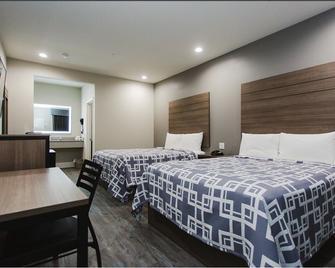 Palace Inn Conroe - Conroe - Bedroom