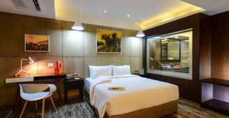 Howard Johnson by Wyndham Kolkata - Calcutta - Camera da letto