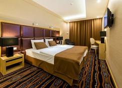Aquaticum Debrecen Thermal and Wellness Hotel - Debrecen - Makuuhuone