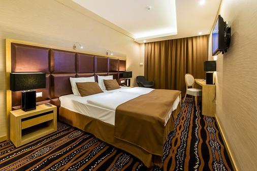 Aquaticum Debrecen Termal & Wellness Hotel - Debrecen - Bedroom