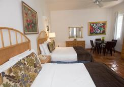 At Wind Chimes Boutique Hotel - San Juan - Makuuhuone
