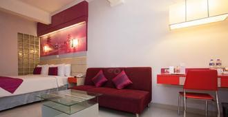 Favehotel Premier Cihampelas - Бандунг - Спальня