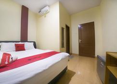 RedDoorz Near Tvri Gorontalo - Gorontalo - Schlafzimmer