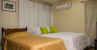 Hostal Casa Los Espinoza - Managua - Schlafzimmer