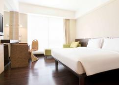 Novotel Manado Golf Resort & Convention Center - Manado - Bedroom